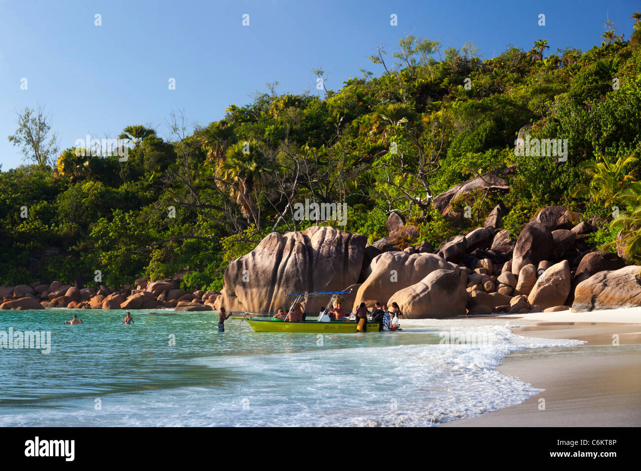 Granite boulders on the shore at Anse Lazio, Baie Sainte Anne district, Island of Praslin, Seychelles, Indian Ocean, - Stock Image