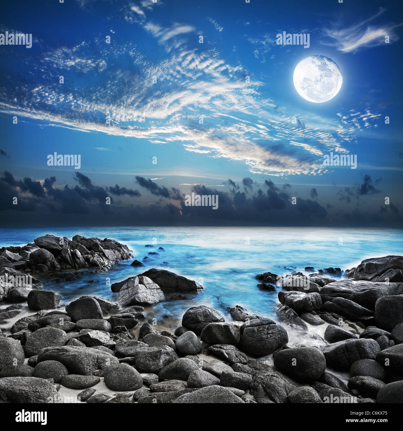 Full moon over the tropical bay. Long exposure shot. - Stock Image