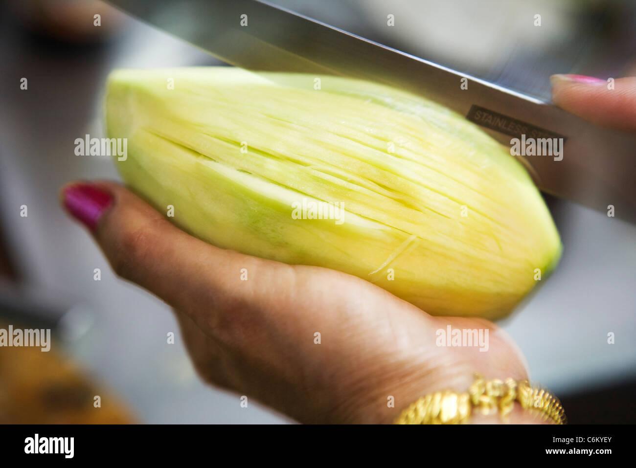 Slicing fresh mango - Stock Image