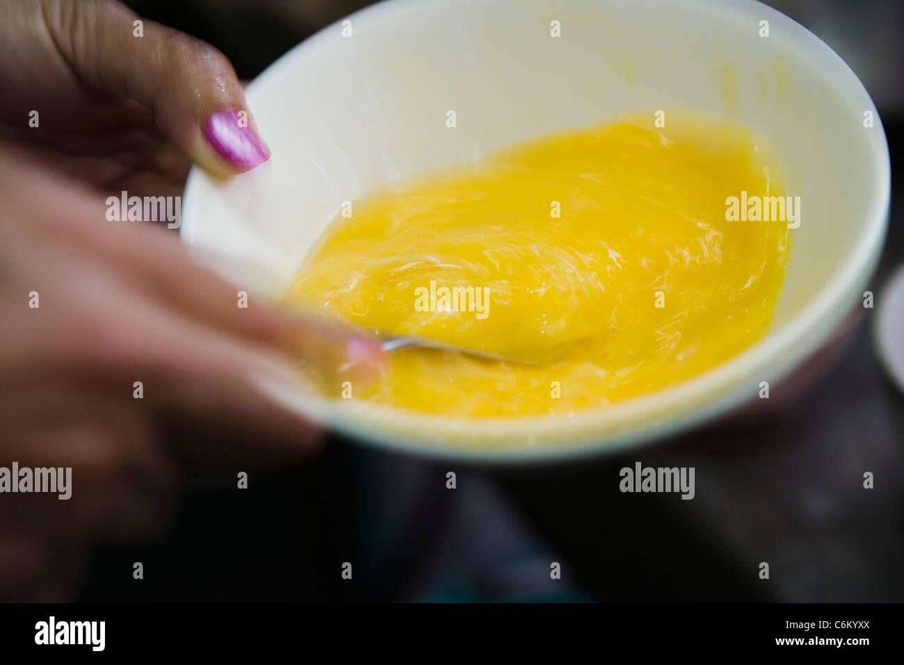 Whisking eggs - Stock Image
