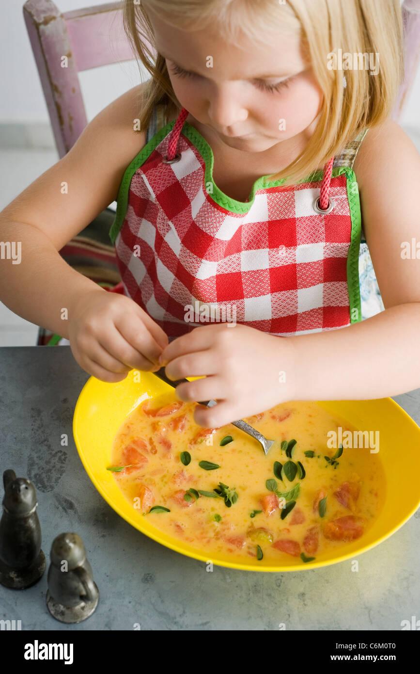 Little girl preparing food - Stock Image