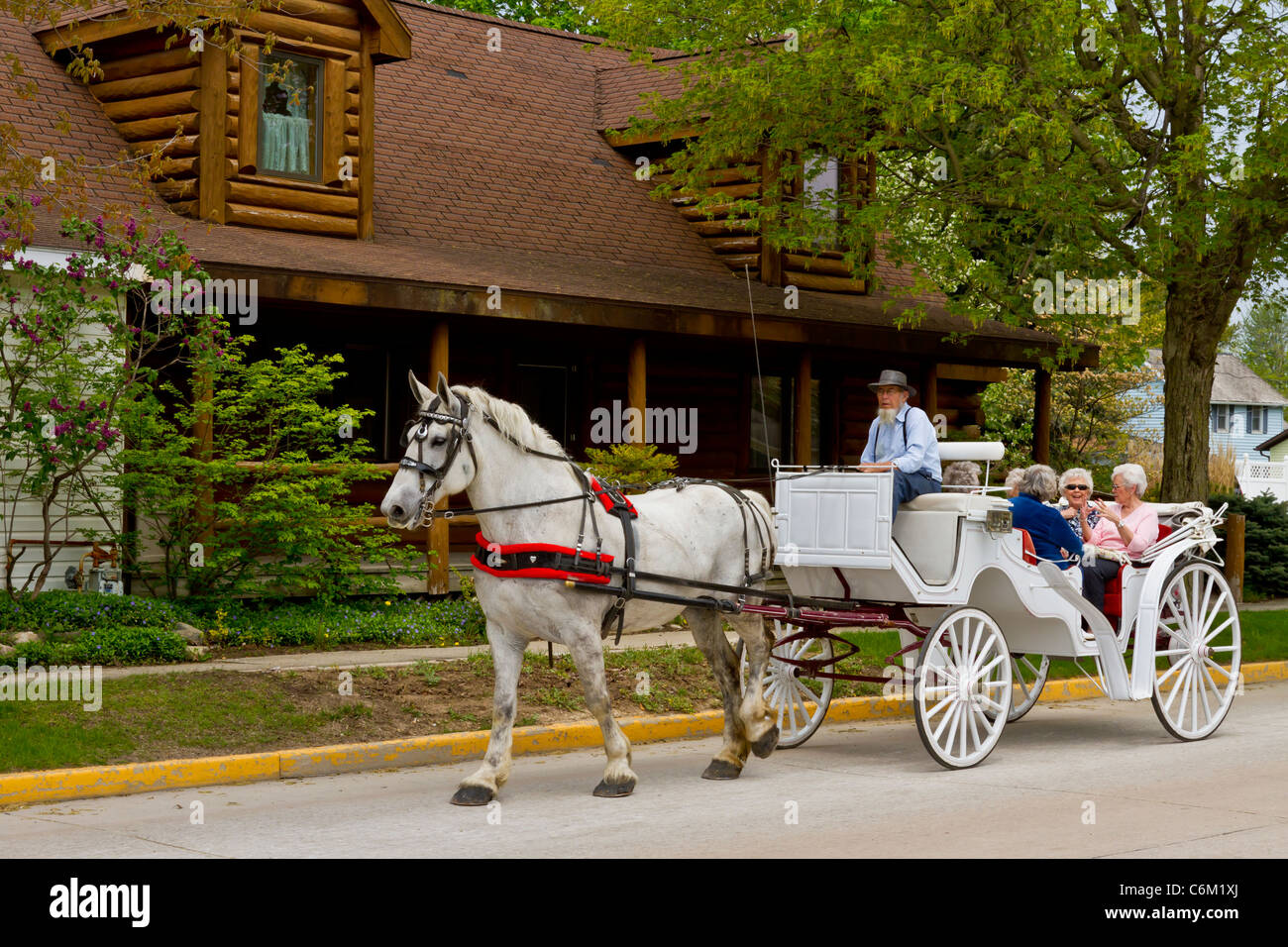 Horse and buggy rides for tourists in Shipshewana, Indiana, USA. - Stock Image