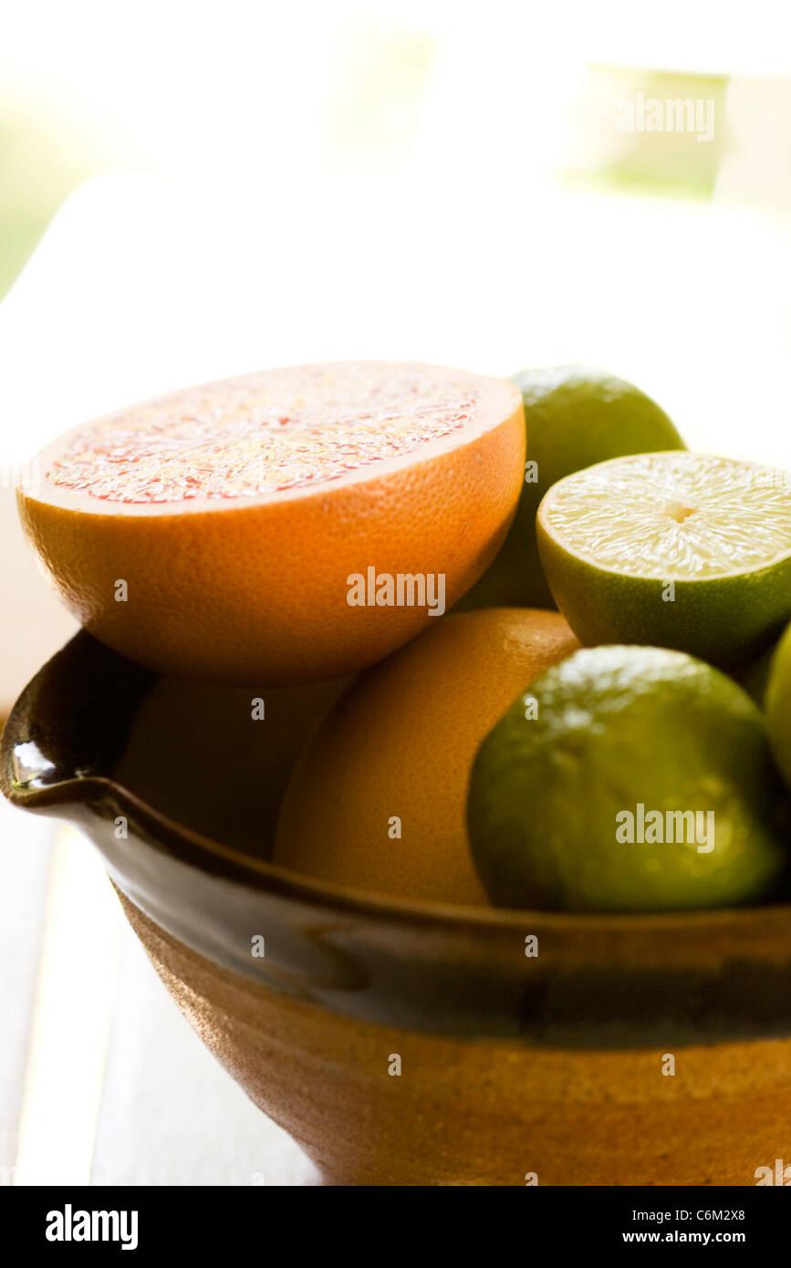 Sliced grapefruit, limes Stock Photo
