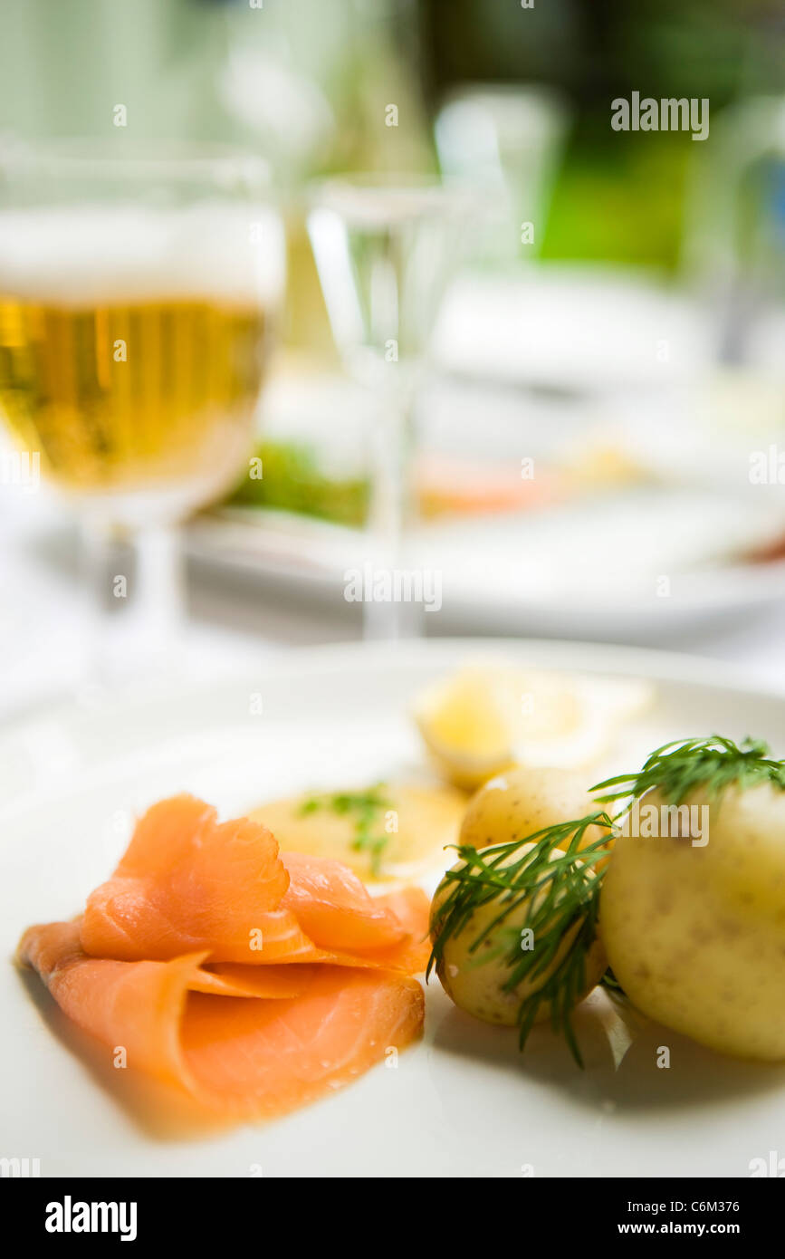 Smoked salmon served with new potatoes - Stock Image