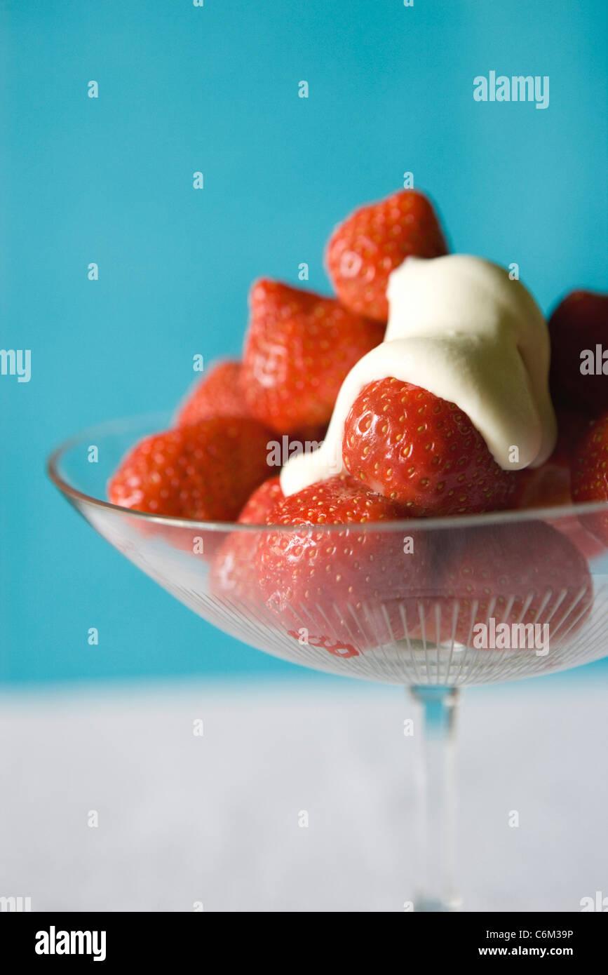 Fresh strawberries with cream - Stock Image