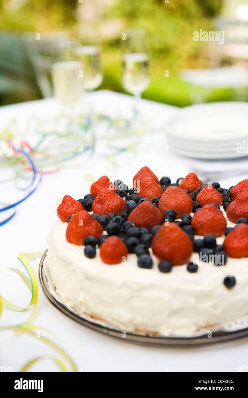 Strawberry blueberry cake - Stock Image