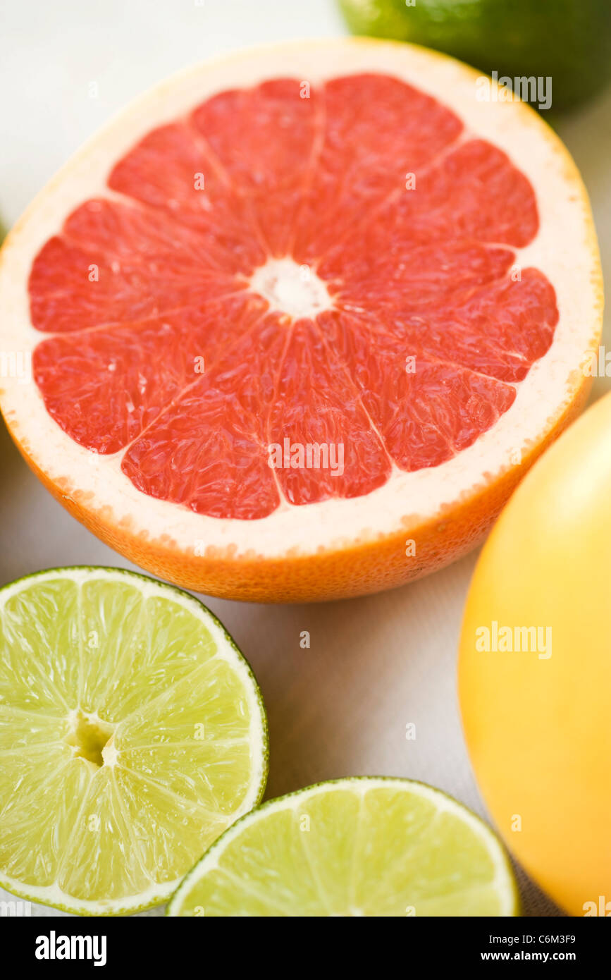 Grapefruit and lime halves Stock Photo