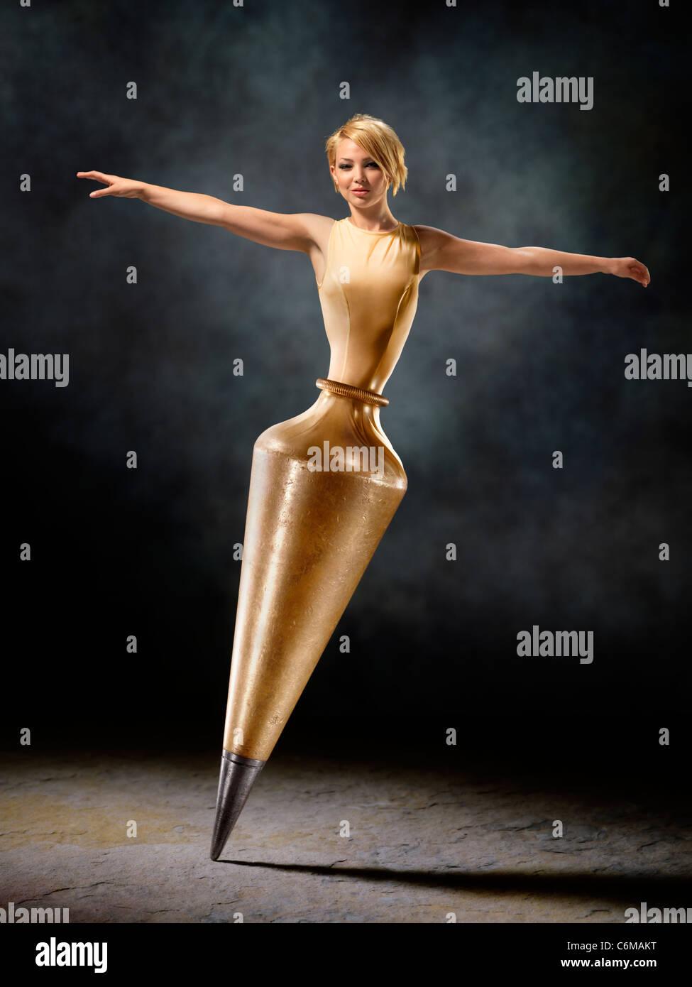 fantasy image of woman dancer morphing into brass plumb bob Stock Photo