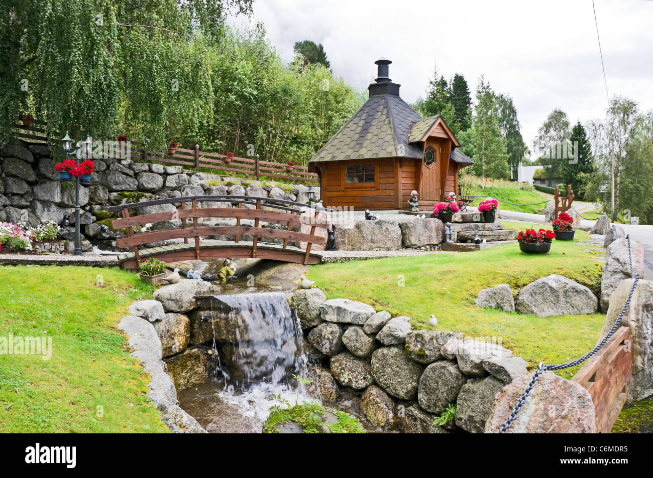 A garden with trolls in Olden on the Innvikfjorden in Norway - Stock Image