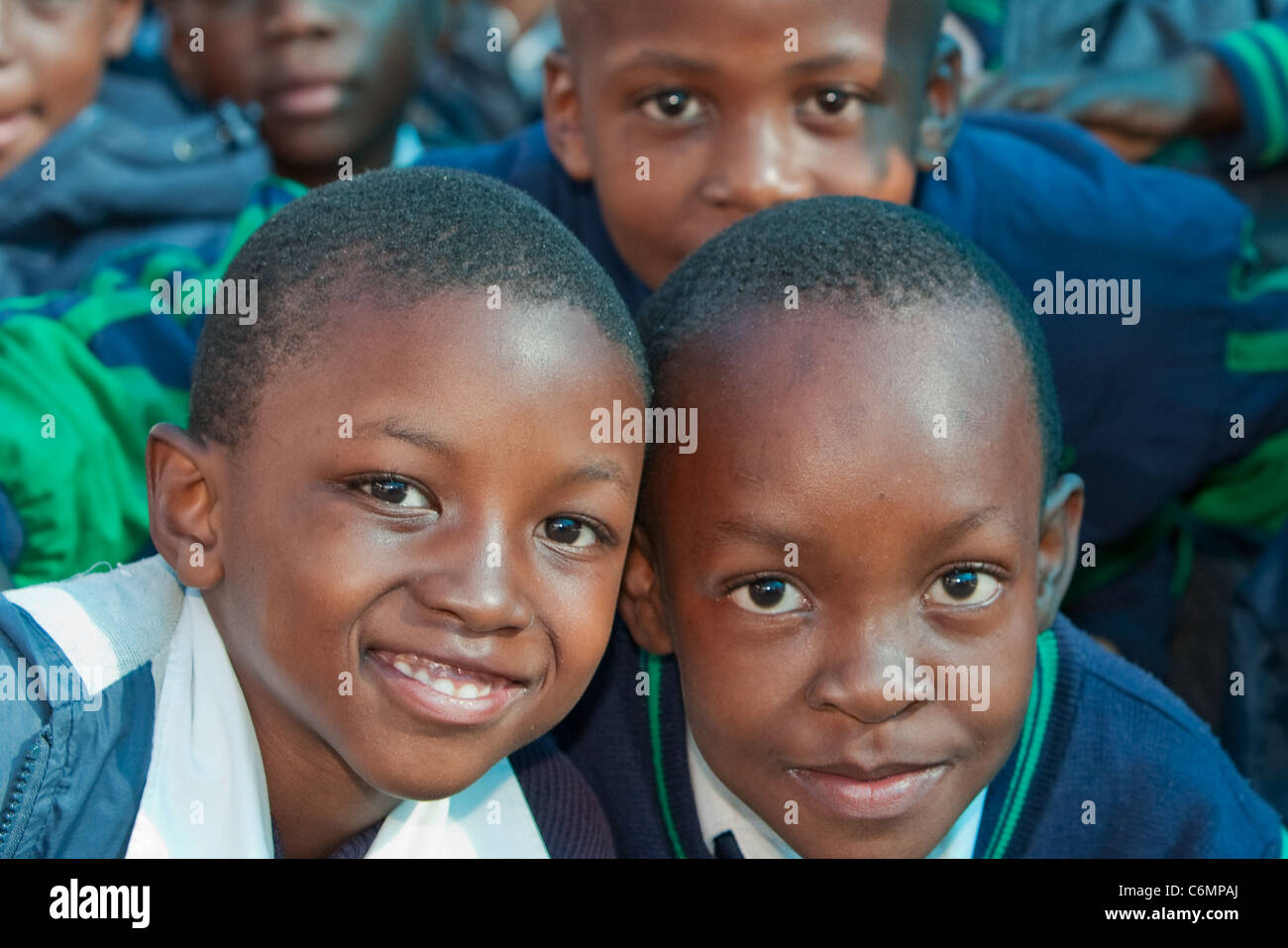 Primary school children at a rural school posing for the camera - Stock Image