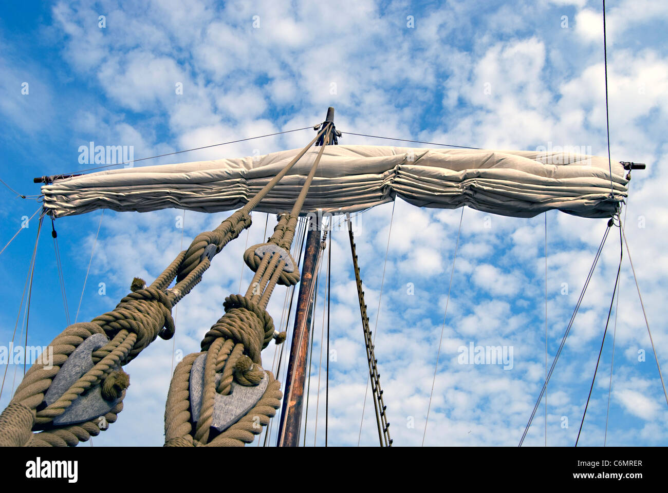 Mainsail on a medieval cog, blue sky and clouds in the background - Stock Image