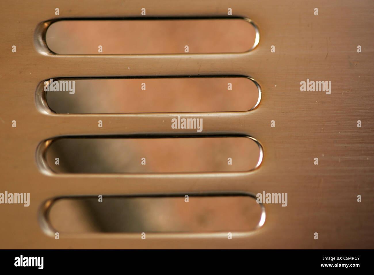 Close up of rectangular shapes cut of  metal - Stock Image