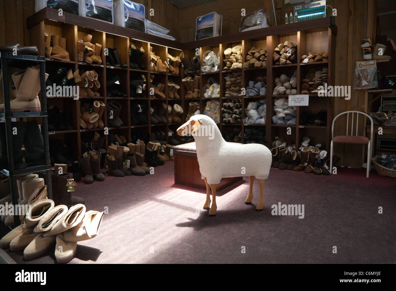 The interior of shop at Sheep World farm and nature park. Auckland, North Island, New Zealand. Wool lined slippers - Stock Image