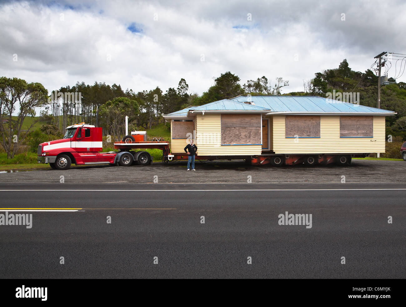 A relocatable house being towed on a trailer to another location. Parked in a lay-by. Auckland region. North Island, Stock Photo