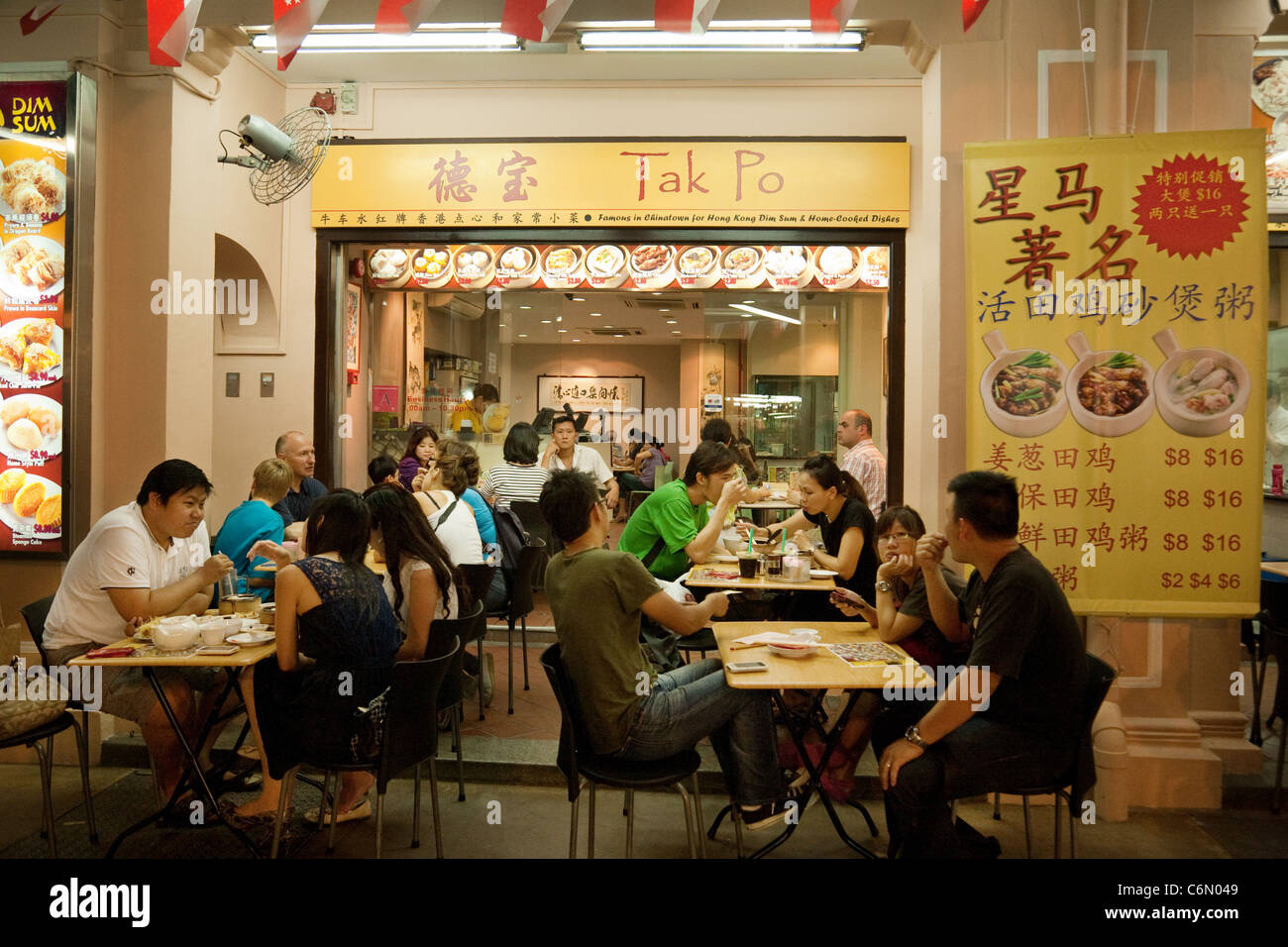 People Eating Outdoors At A Chinese Restaurant Chinatown
