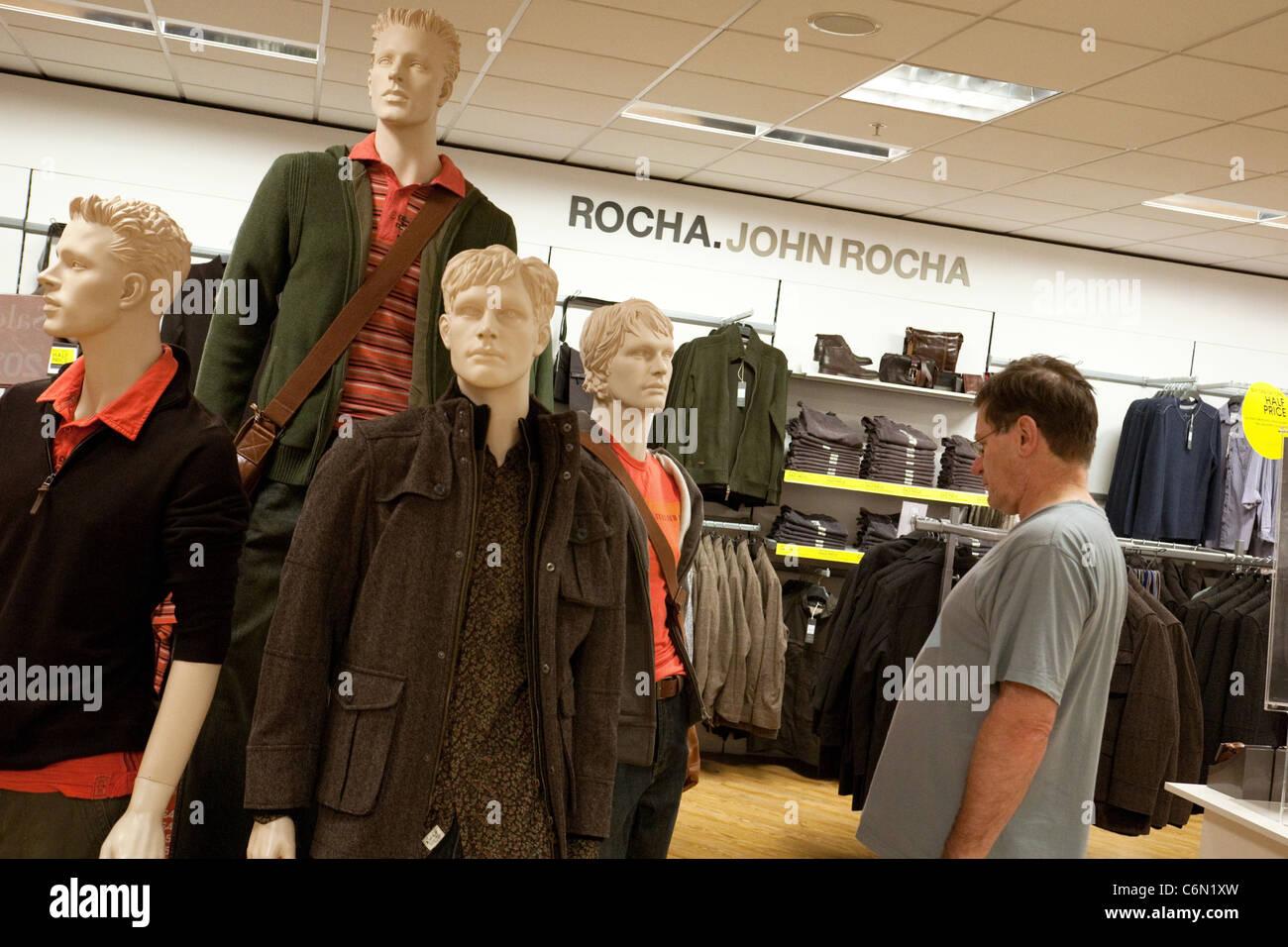 A man shopping for clothes, John Rocha store, UK - Stock Image