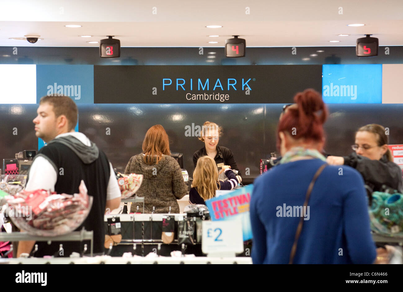 People shopping inside Primark clothes store Cambridge UK - Stock Image
