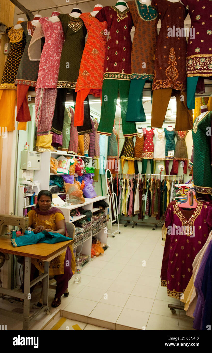 471b7fb56d An Indian tailor working in a clothes shop, the Tekka Market, little India,