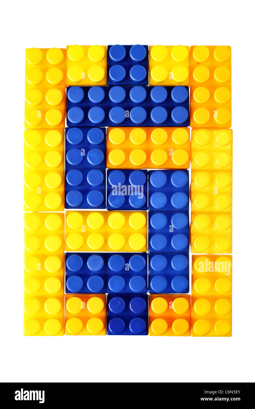 Dollar sign made from building block of meccano isolated over the white background - Stock Image