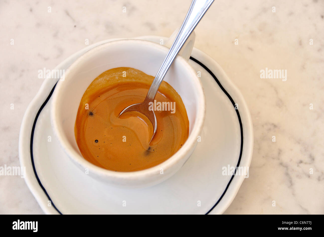 An espresso cup on a marble table - Stock Image
