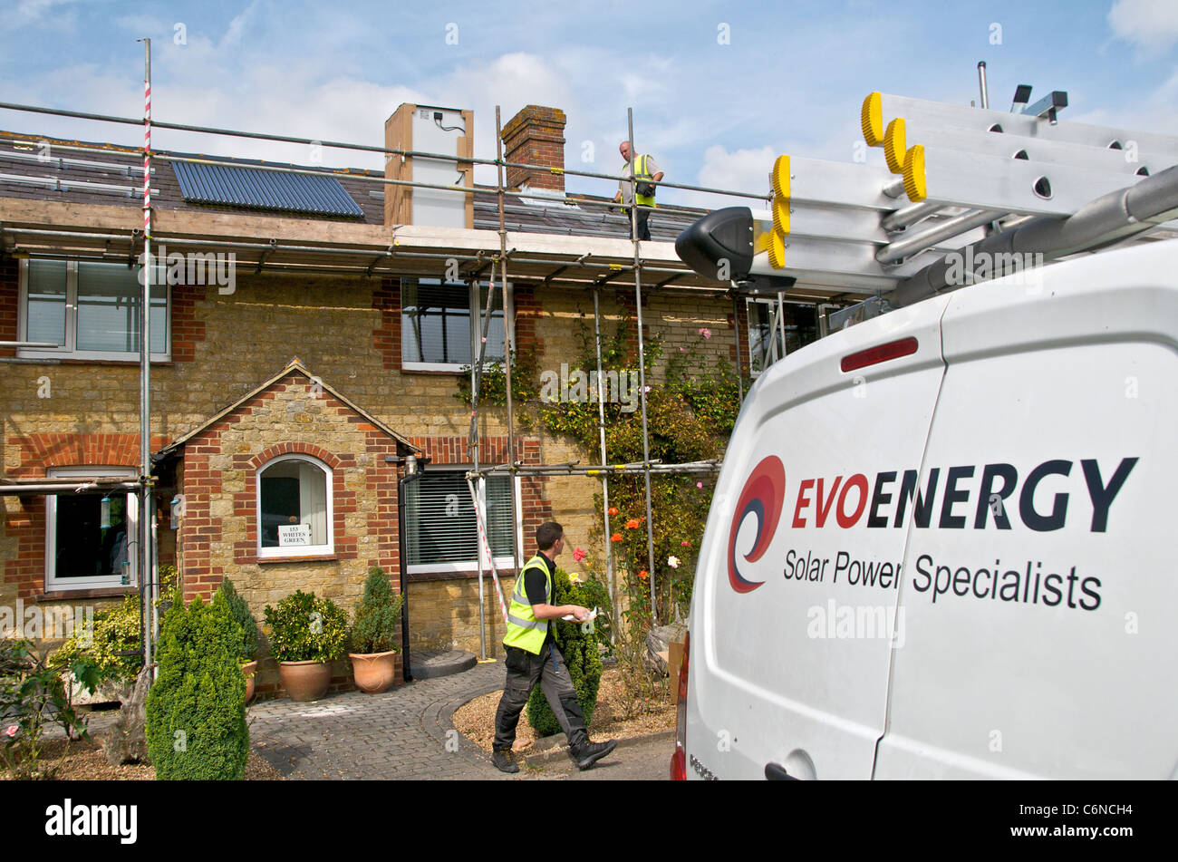 Photovoltaic panels on a roof using solar energy to create electricity Stock Photo