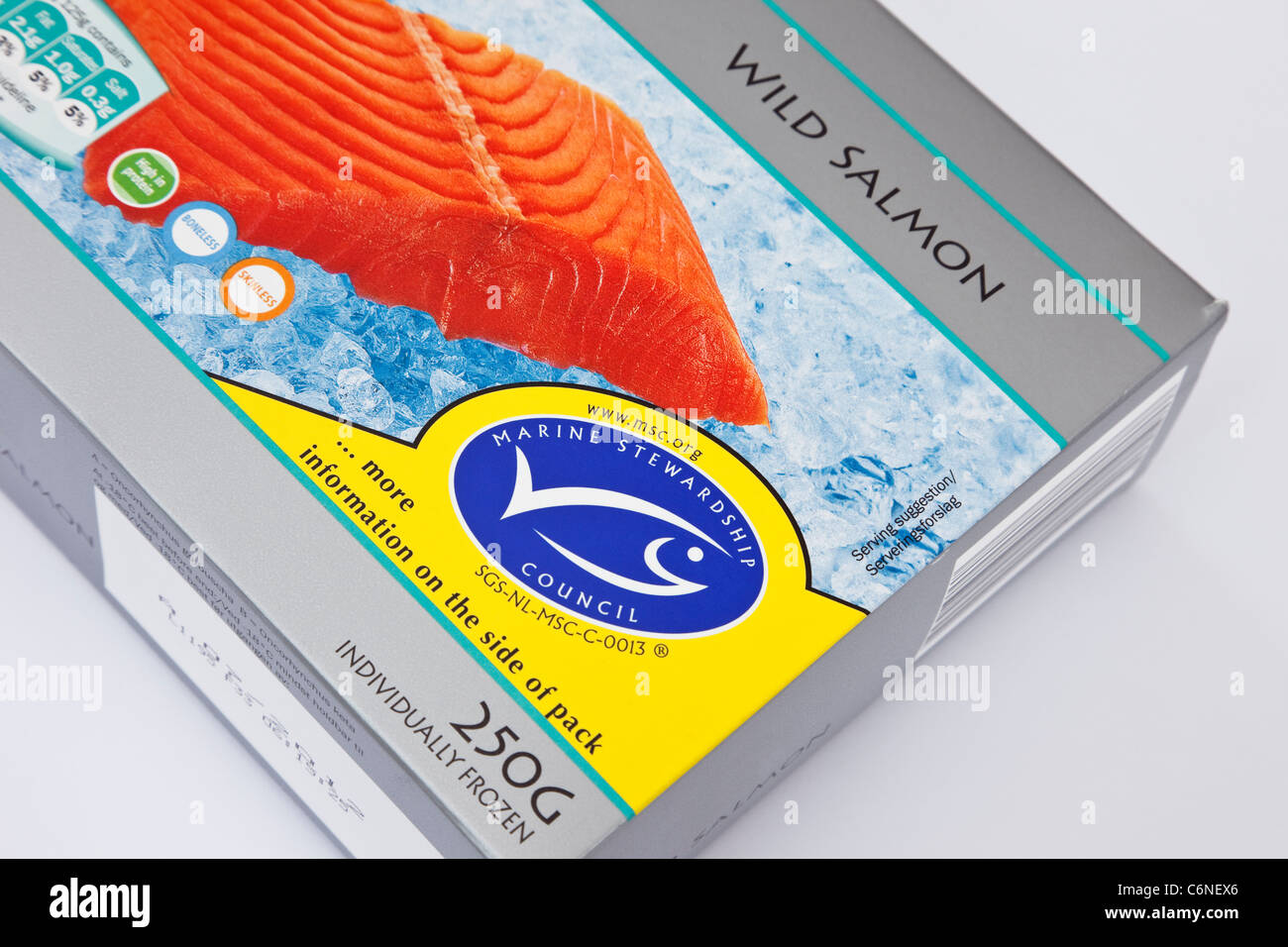 Packet of frozen wild salmon fillets with Marine Stewardship Council label and logo - Stock Image