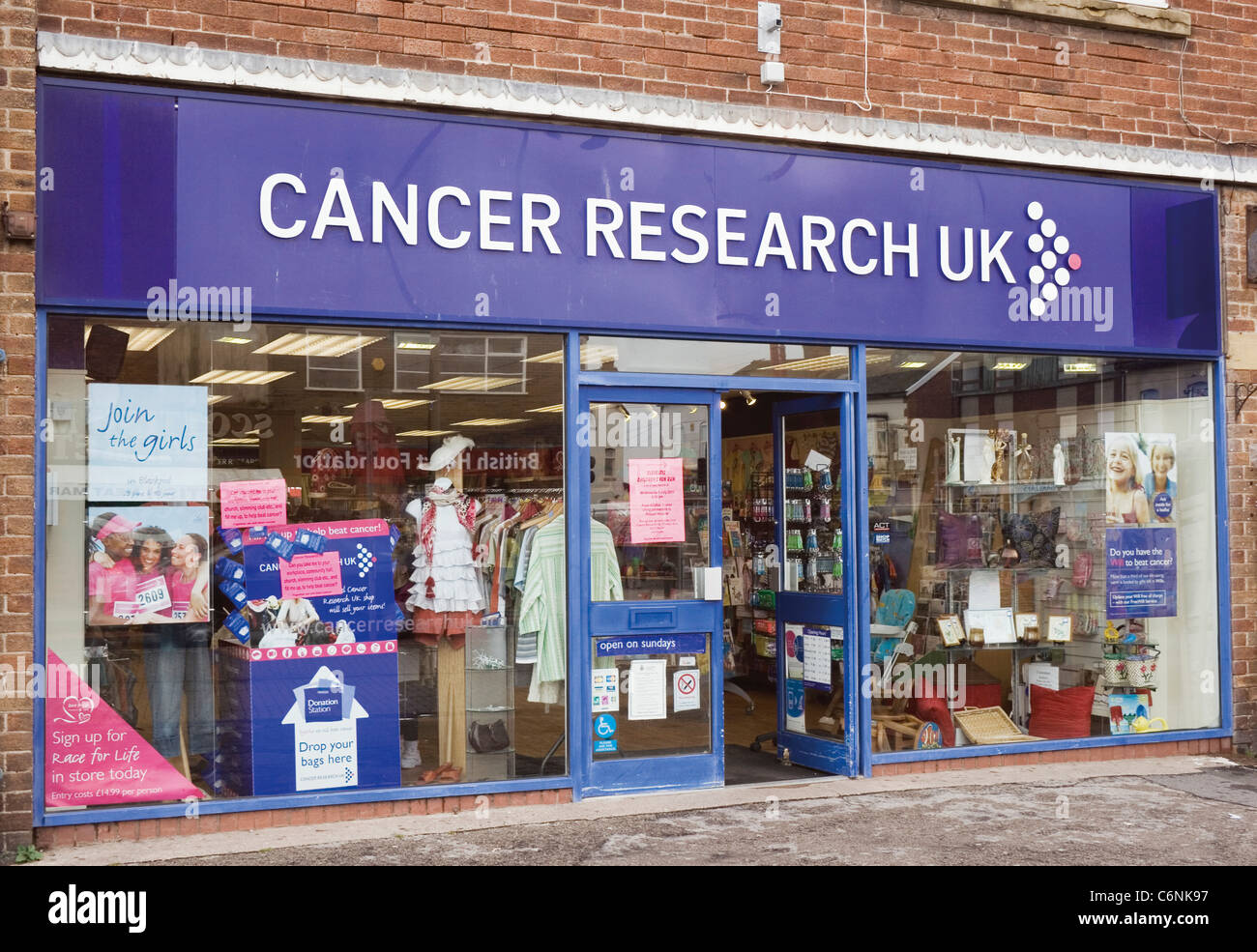 Cleveleys, Blackpool, Lancashire, England. Cancer Research UK charity shop. - Stock Image