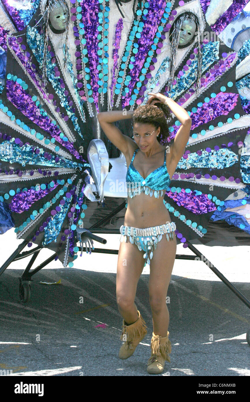 One of the people pulling a float takes a break in the grand Mas at the Caribana festival in Toronto, - Stock Image