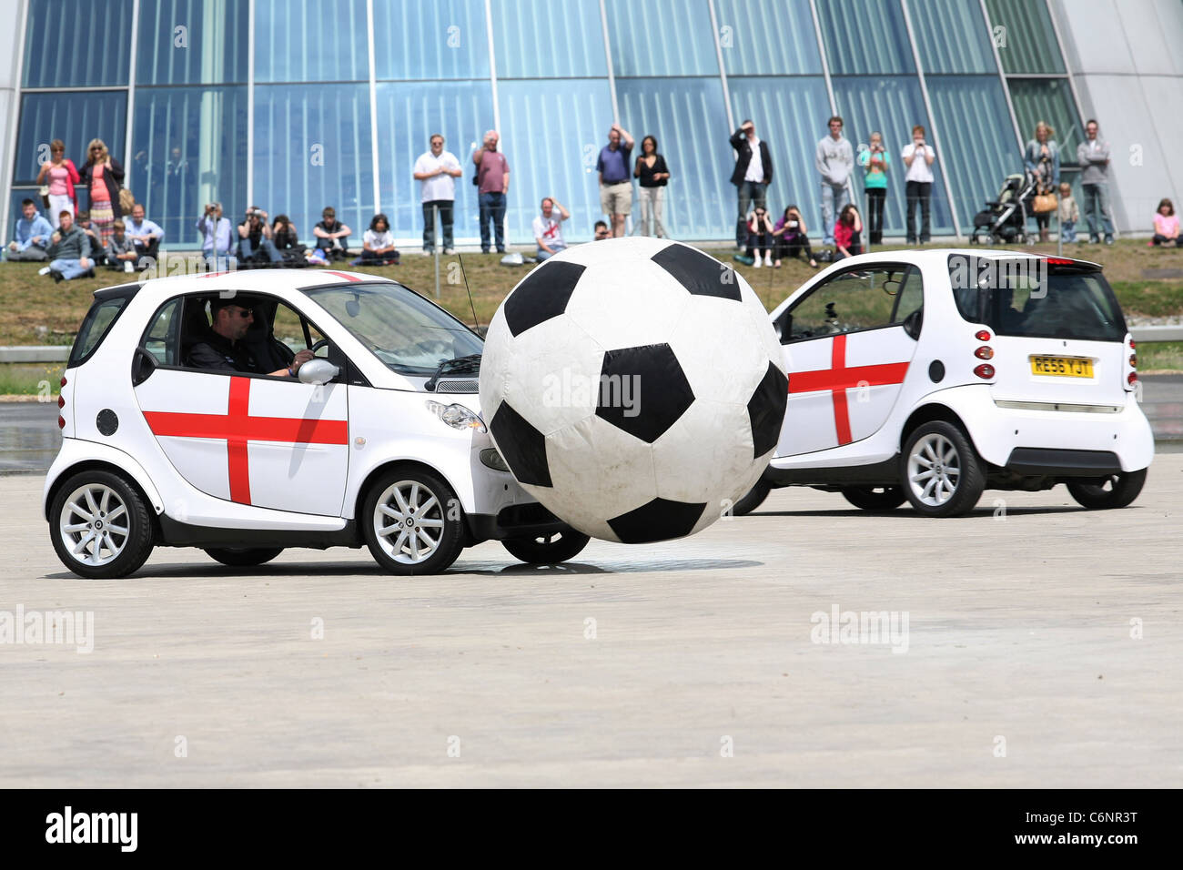 Smart Footie England takes on the rest of the world as eight smart cars entertain the crowds at Mercedes-Benz World - Stock Image