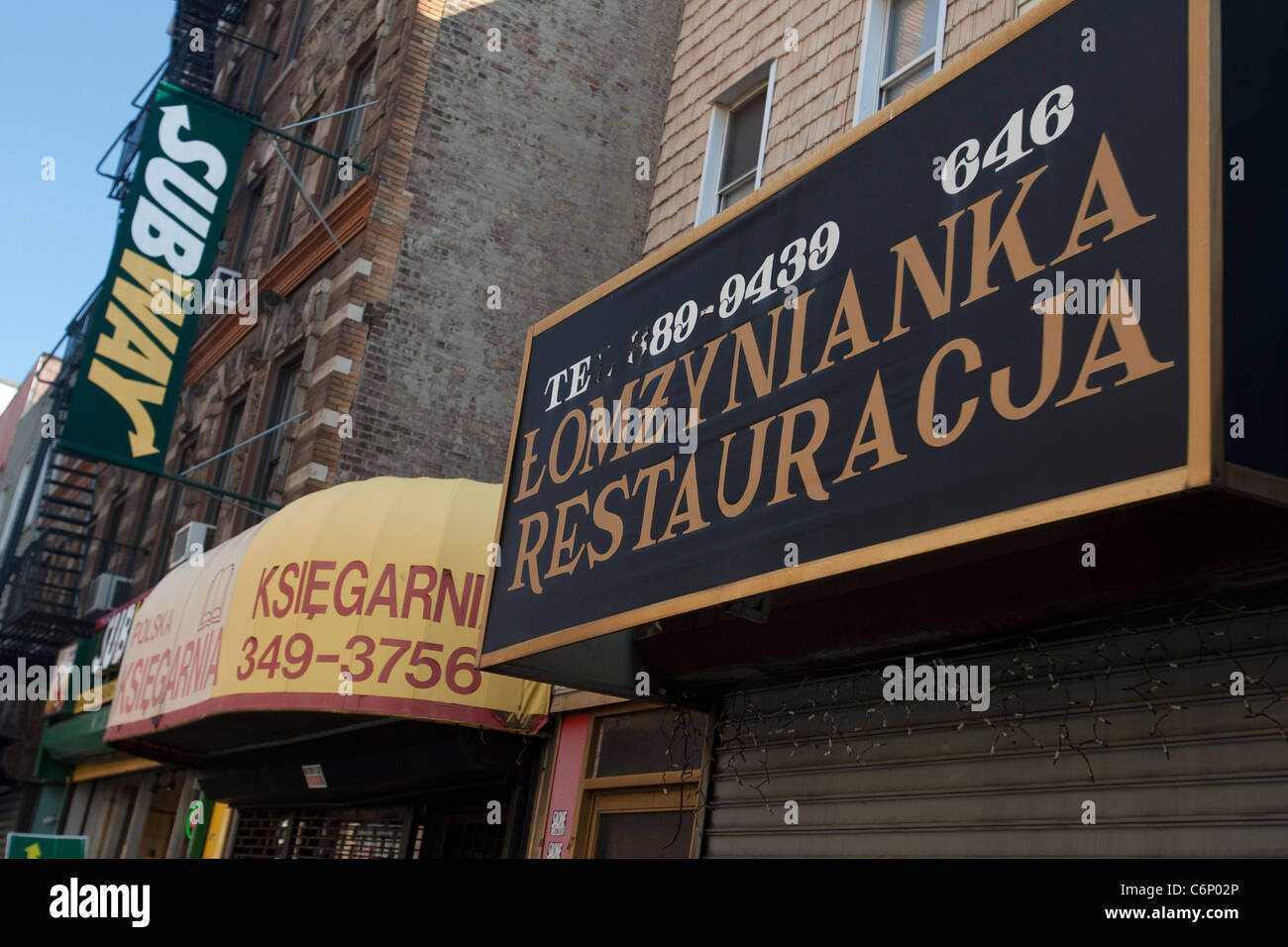 Two Polish stores are pictured by a Subway restaurant in the Greenpoint neighborhood of New York City - Stock Image
