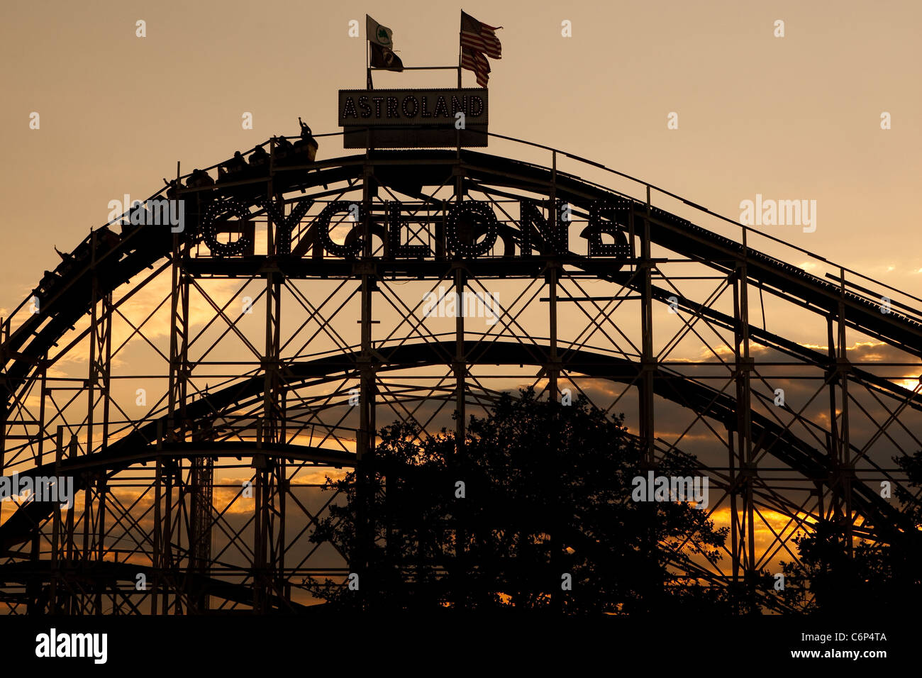 The Sun Set On The Coney Island Cyclone Roller Coaster On Coney Stock Photo Alamy