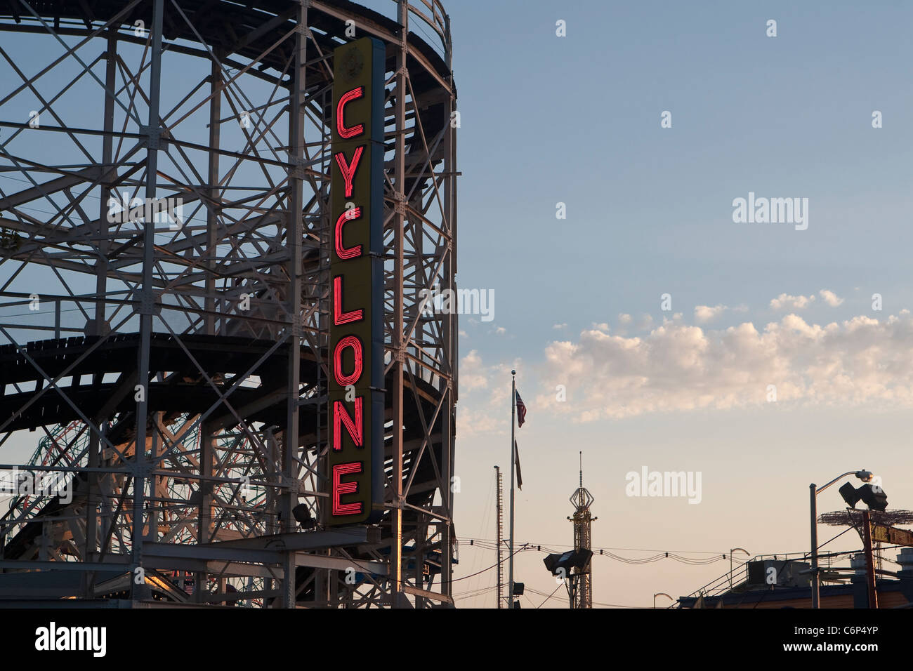 The sun set on the Coney Island Cyclone roller coster on Coney Island in New York city borough of Brooklyn - Stock Image