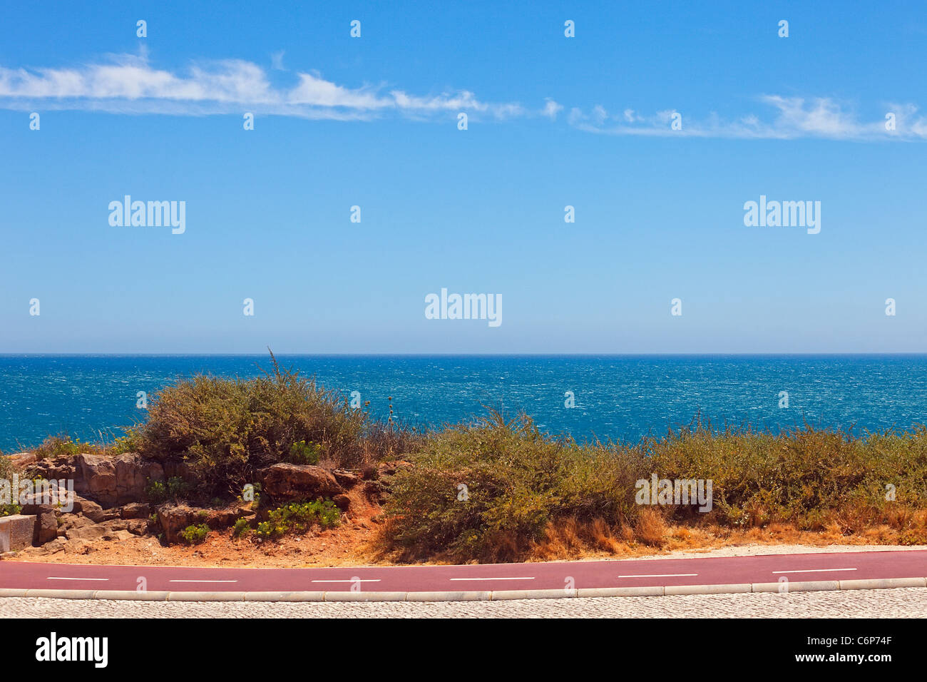 Cycleway on the Atlantic seaboard. Landscape with smooth ocean and blue sky. Stock Photo