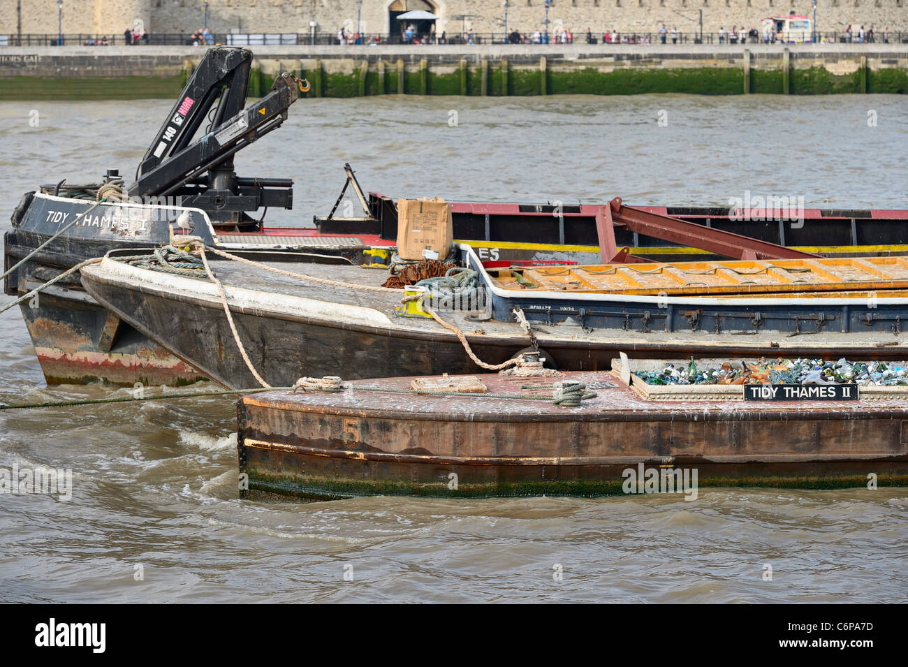 Detail of waste disposal barges on the River Thames, London, England, UK, Europe - Stock Image