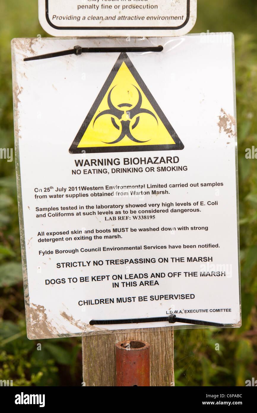 A warning about E. coli contamination on marshland on the Ribble Estuary at Warton, UK. - Stock Image