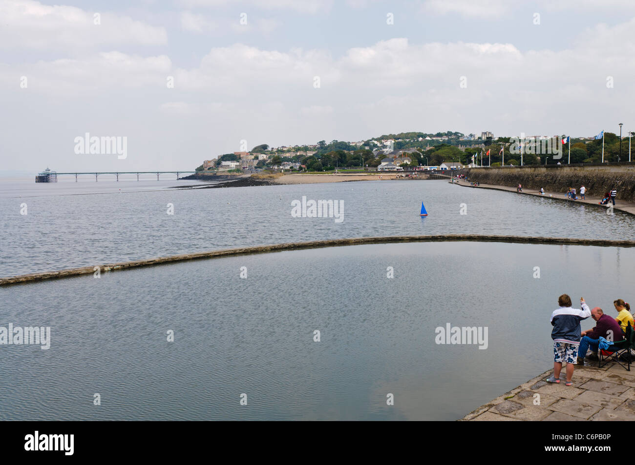 The Marine Lake, Clevedon, with Clevedon pier in the background - Stock Image