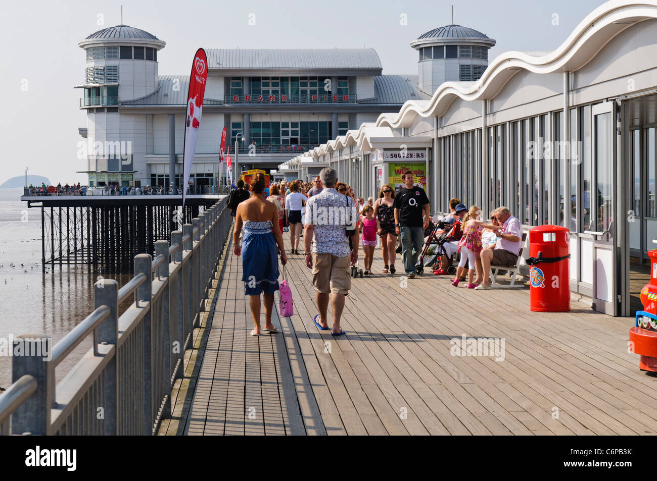 People walking along the Grand Pier, Weston Super Mare - Stock Image