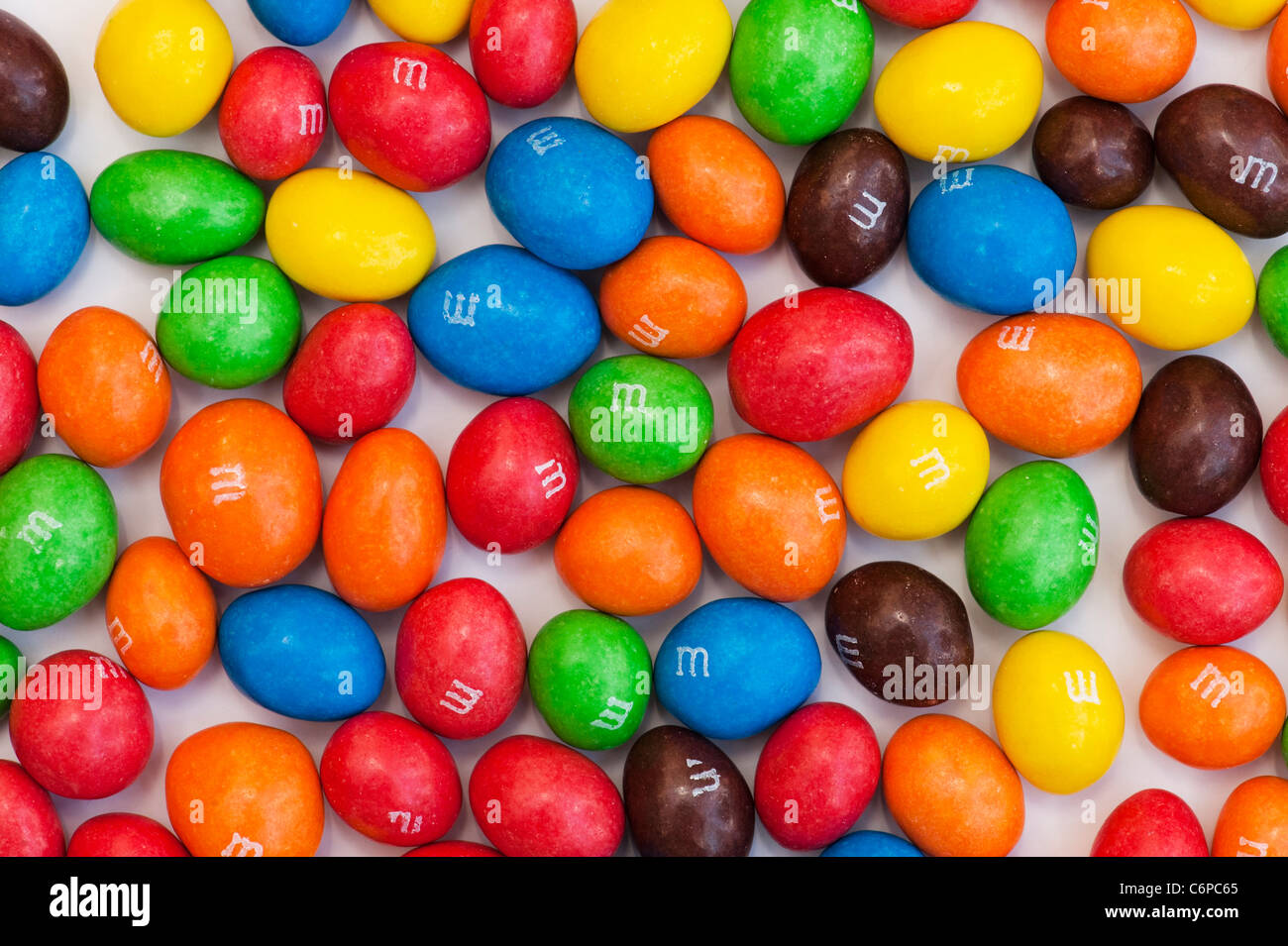 M & M s on white background - Stock Image