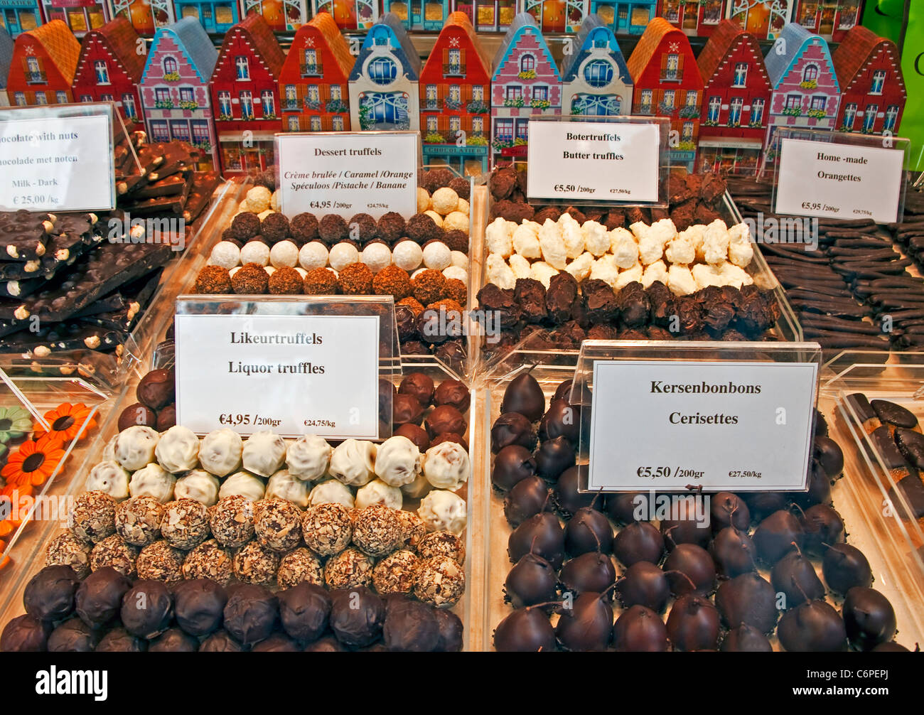 Belgian chocolates in Bruges (Brugge) shop window on Dijver street - Stock Image
