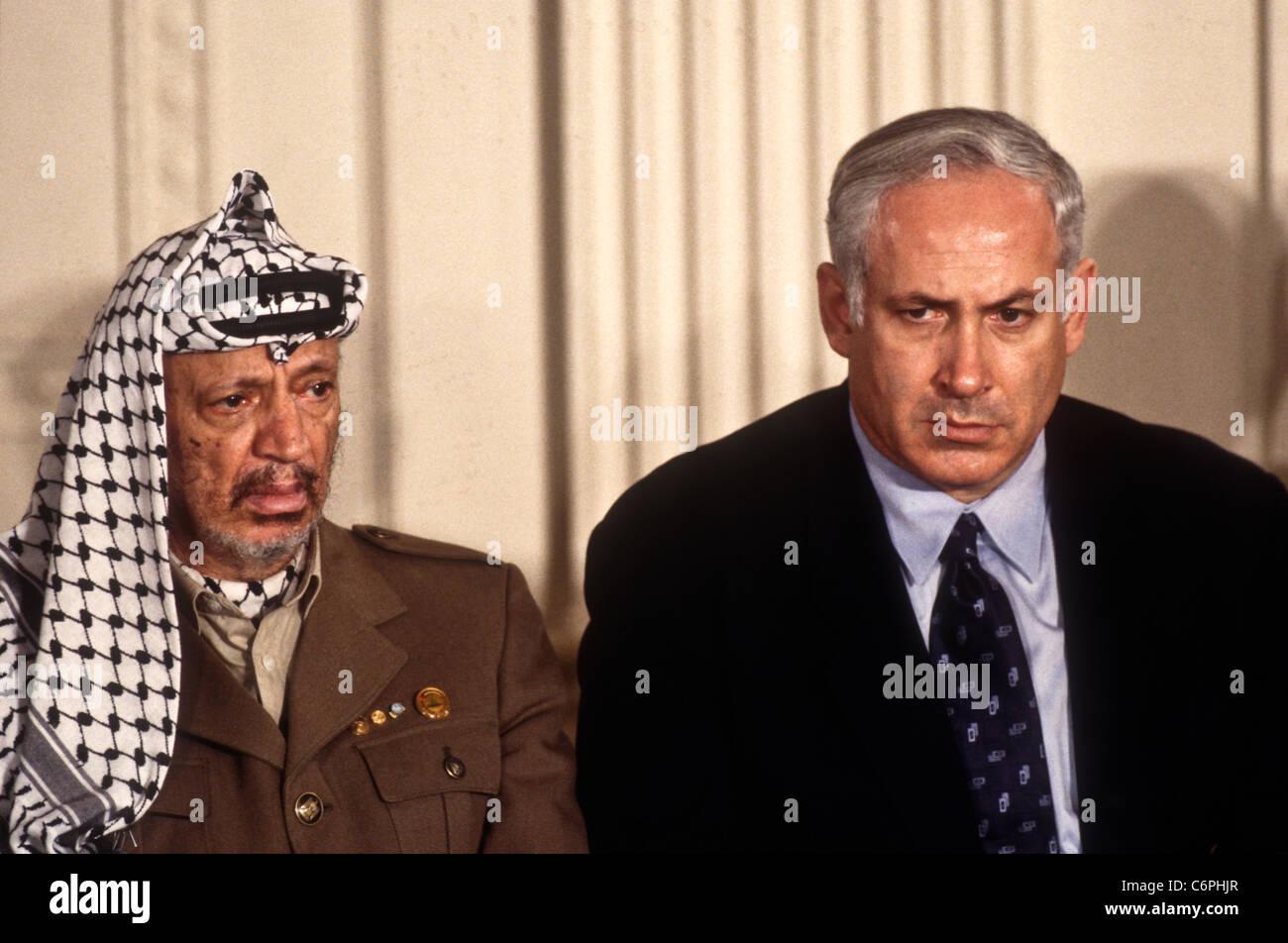 plo leader yasser arafat sits with israeli prime minister benjamin