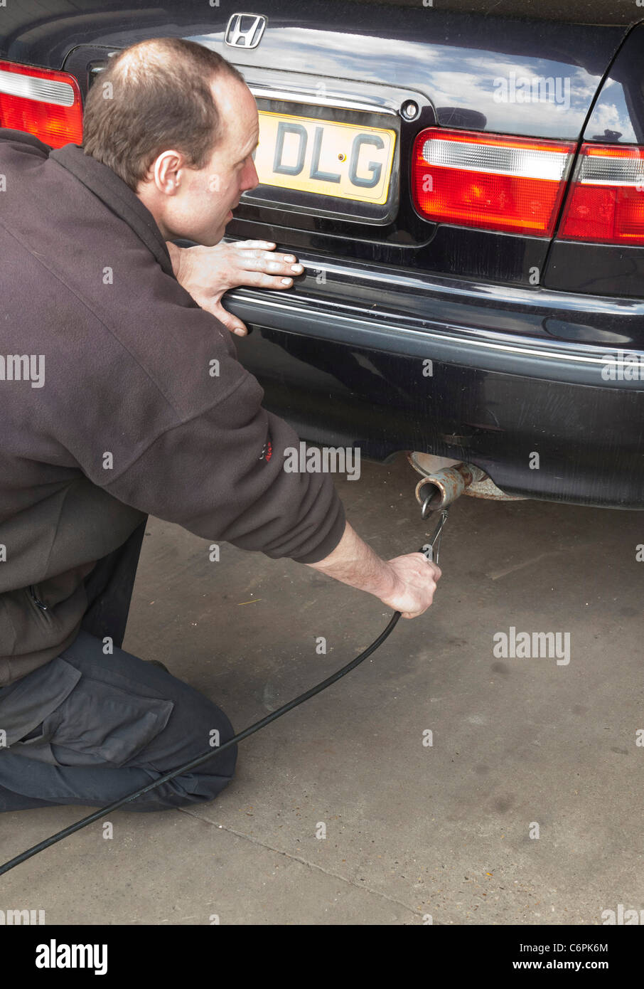 exhaust emissions test during an MOT check for a car in UK - Stock Image