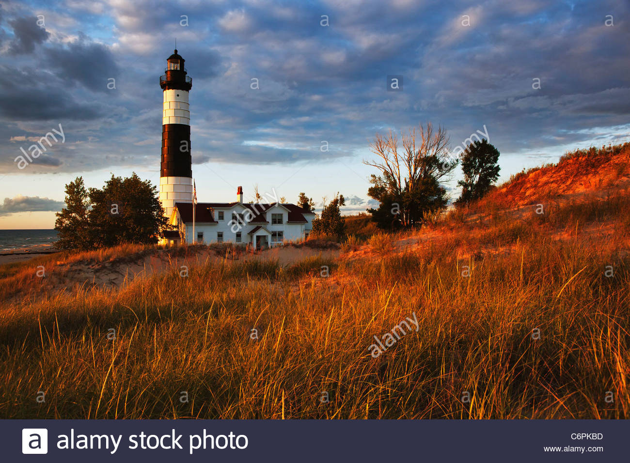 Big Sable Lighthouse at sunset in Ludigton State Park, Ludington, Michigan - Stock Image