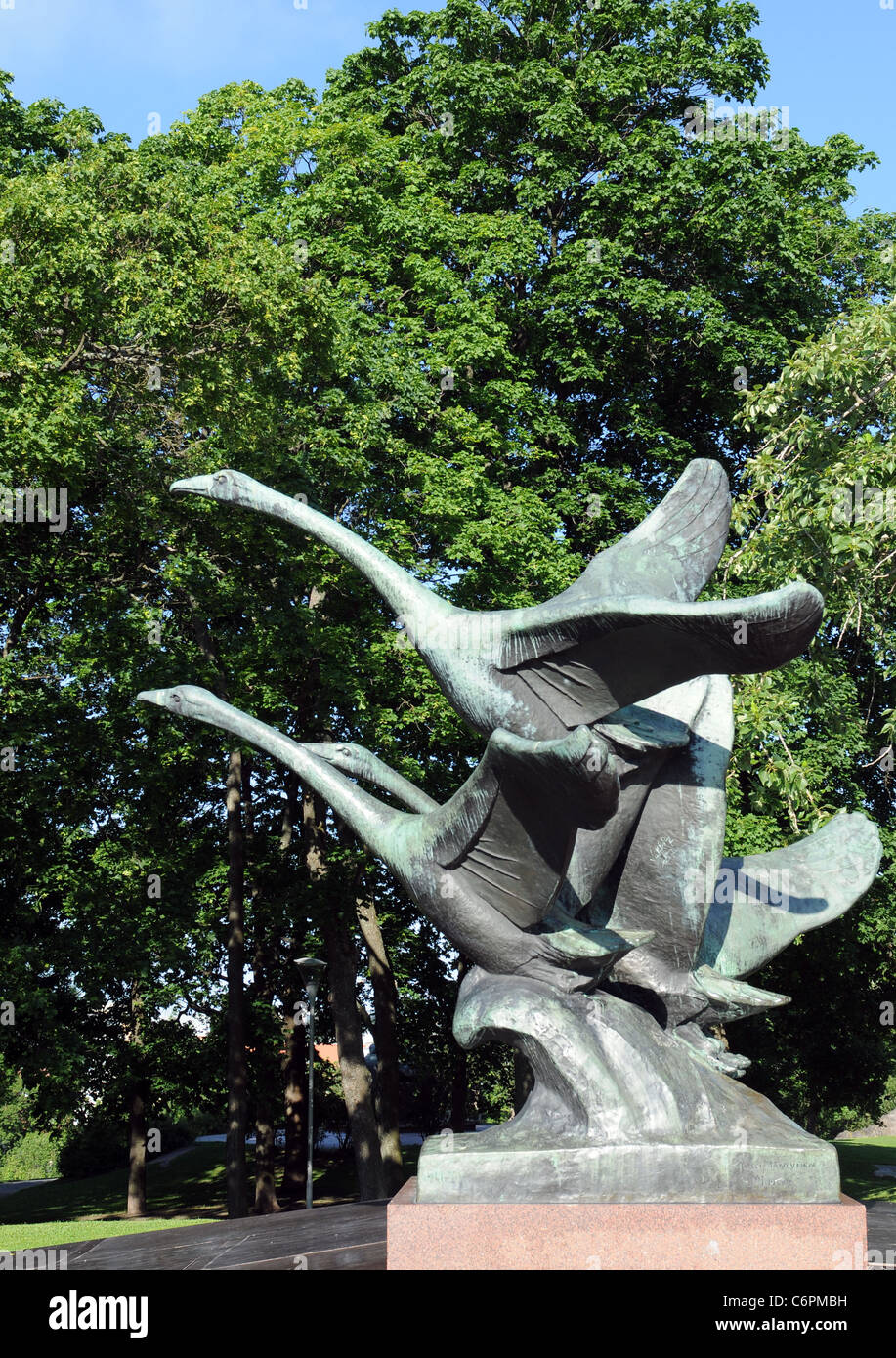 "The sculpture ""Flying Swans"" stand in front of the Turku Art Museum and was made by Jussi Maentynen Stock Photo"