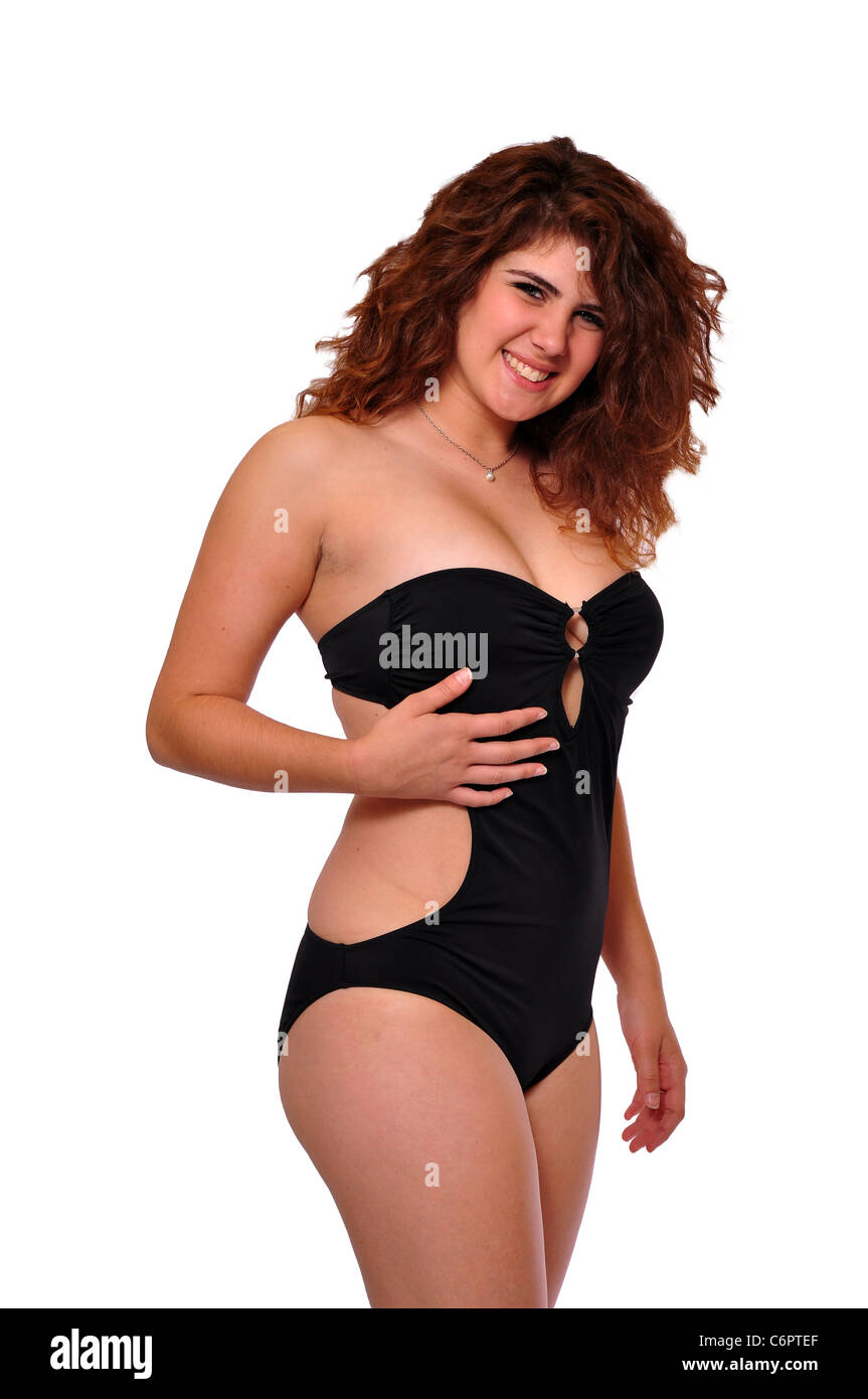 967597947f3336 A young 20 something swimsuit model is posing on a black background. -  Stock Image