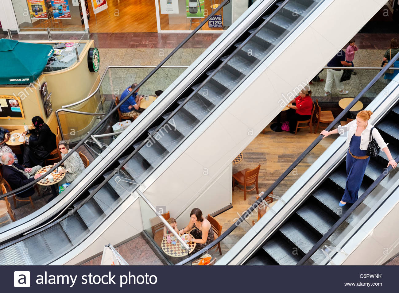 Escalators at Cribbs Causeway shopping mall, Bristol, England, UK. - Stock Image