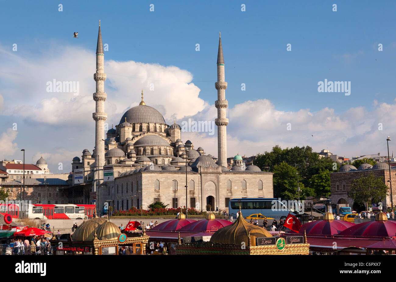 Attractive colorful roofs of the pleasure boats with the Yeni Camii Mosque (New Mosque) in the background, Eminonu, - Stock Image