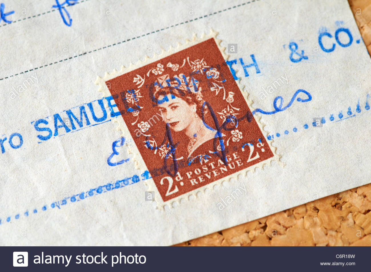 old brown 2d stamp on a paid receipt from the 1960s showing the queens head - Stock Image