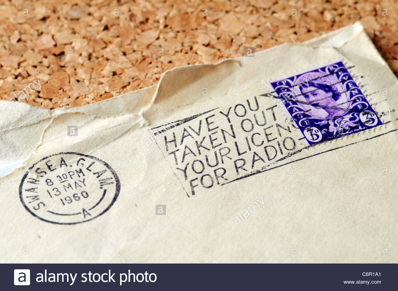 postmark on envelope with old 3d three pence stamps dated 1960 reminding you to buy radio tv licence - Stock Image