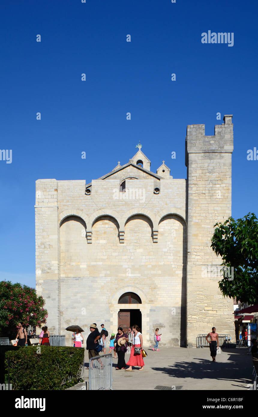 Tourists Outside the Fortified Church of Les Saintes-Maries-de-la-Mer or Les Saintes Maries de la Mer Camargue Provence - Stock Image