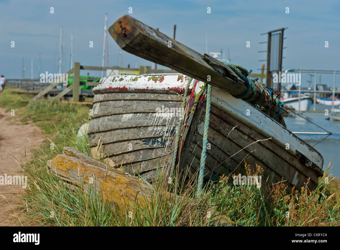 Rowing boat marooned on riverbank UK Boats - Stock Image